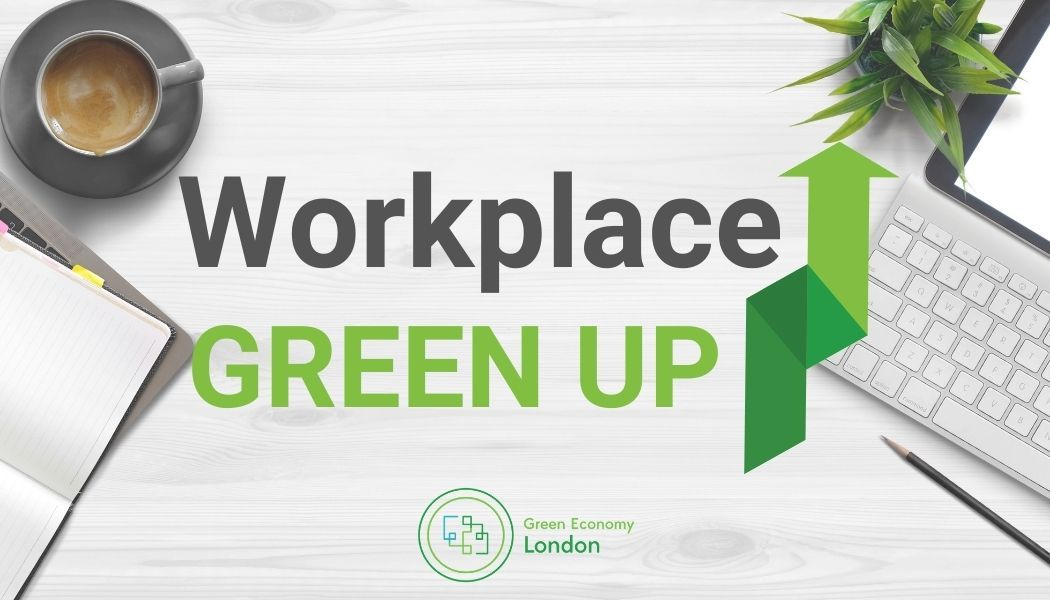 Workplace Green up logo on a computer desk.